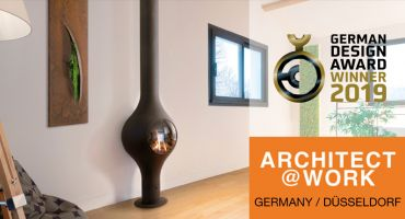 cheminée contemporaine poêle design moderne architecture decoration centrale suspendue gaz poële architecte conception salon Architect@Work